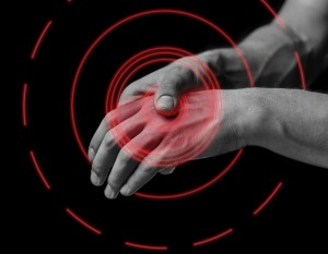 Pain in a male hand. Man holds his hand, black and white image, pain area of red color